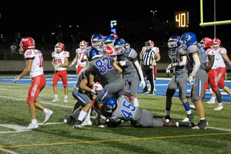 Kameron Gethers (11) gets trapped under the pile as Nick Engelhaupt (12) and other players tackle a Crown Point player trying to run the ball. LC's defense was a relatively strong force to be reckoned with during the tough game.  Photo by: Alison Irace