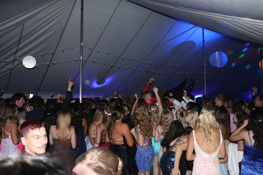 Students are gathering under the tent to dance. A student was crowd surfing.
